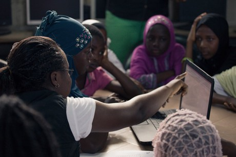 African women accessing data via laptop