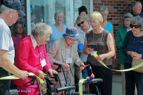 Lucille Machon and Trudie Seybold, both 98 cut the ribbon