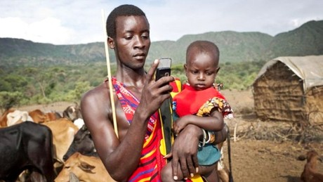 African Farmer with Mobile Internet Access