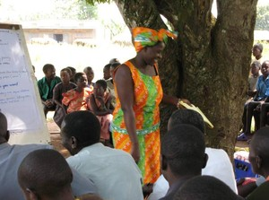 Resty Namubiru, when she was an African Rural University student, working with villagers to elicit their visions and current reality.