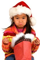 Unhappy Child with empty Christmas stocking